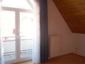 Das Schlafzimmer mit Balkon